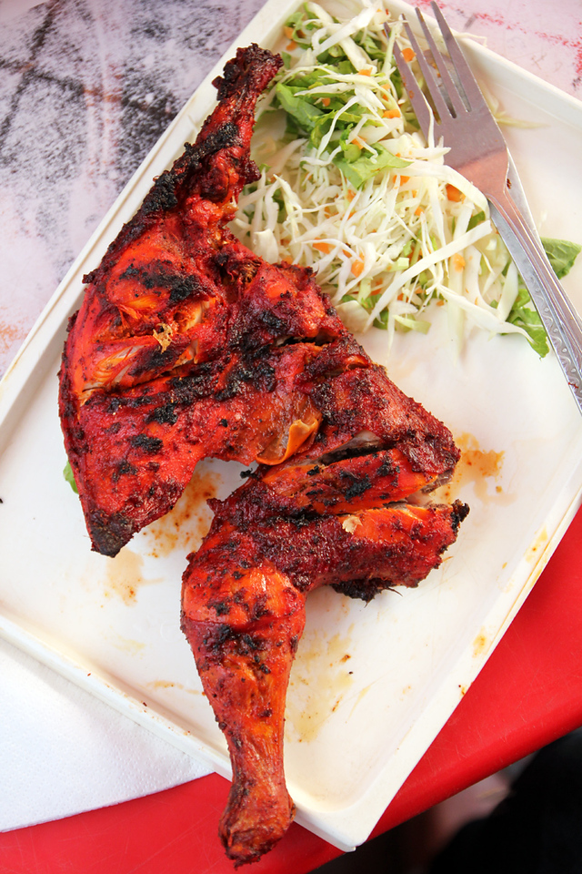 Grilled tandoori chicken at Mukhy's Cafe in Stone Town, Zanzibar